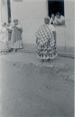 view [Menininha and her filhas standing outside and leaning out of window of Gantois temple], 1938 September 14 digital asset number 1