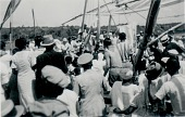 view [Crowd looking at white satin embroidered flag for Iemanjá, mãe d'agua, ceremony at Itapagipe], 1938 September 18 digital asset number 1