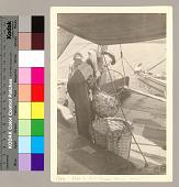 view [Cajun fishman pouring shrimp into basket], 1943 August digital asset number 1