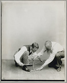 view Dr Walter Hough, demonstrating the use of an Eskimo strap drill before 1935 digital asset number 1