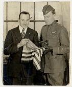 view Photograph of Captain Benjamin B. Lipsner and Major Cushman A. Rice with flag digital asset number 1