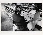 view Photograph of postal employee working in a mail processing center digital asset number 1