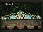 view [Naumkeag]: ornamental wood carving atop the brick wall above the teak bench at the Rond Pointe. digital asset: [Naumkeag]: ornamental wood carving atop the brick wall above the teak bench at the Rond Pointe.: 1985 Aug.
