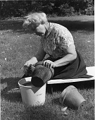view [Demonstration of Planting Techniques]: scrubbing pots before use. digital asset: [Demonstration of Planting Techniques] [photographic print]: scrubbing pots before use.