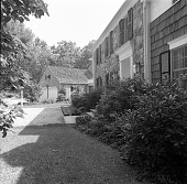 view [Mulvilhill Garden]: front façade of house, looking toward garage. digital asset: [Mulvilhill Garden] [safety film negative]: front façade of house, looking toward garage.