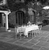 view [Gwin Garden]: dining table on terrace, with pergola on left. digital asset: [Gwin Garden] [safety film negative]: dining table on terrace, with pergola on left.