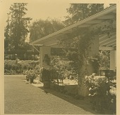 view [Asche Garden]: covered terrace and container plants to right of lawn with perennial beds in background. digital asset: [Asche Garden]: covered terrace and container plants to right of lawn with perennial beds in background.: 1950.
