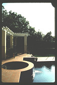 view [Untitled Garden in Los Angeles, California]: raised circular spa with waterfall and pergola beyond. digital asset: [Untitled Garden in Los Angeles, California] [slide]: raised circular spa with waterfall and pergola beyond.