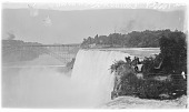 view [Niagara Falls]: the American Falls with the bridge between Canada and the United States in the background. digital asset: [Niagara Falls] [glass negatives]: the American Falls with the bridge between Canada and the United States in the background.