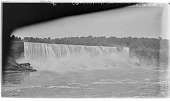 view [Niagara Falls]: the American Falls seen from across the Niagara River. digital asset: [Niagara Falls] [glass negative]: the American Falls seen from across the Niagara River.