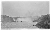 "view [Niagara Falls]: looking toward the Canadian or Horseshoe Falls from the bridge connecting the United States and Canada, with one of the ""Maid of the Mist"" boats in front of the falls. digital asset: [Niagara Falls] [glass negative]: looking toward the Canadian or Horseshoe Falls from the bridge connecting the United States and Canada, with one of the ""Maid of the Mist"" boats in front of the falls."
