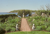 view [Baylis Garden]: perennial garden bisected by brick walkway ending in armillary sphere; view of Sound. digital asset: [Baylis Garden]: perennial garden bisected by brick walkway ending in armillary sphere; view of Sound.: 2005.