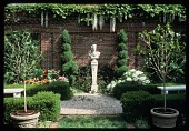 view [Hyland-Schutz Garden]: facing north from center of garden; bust of Apollo with pair of spiral clipped junipers, tree peony. digital asset: [Hyland-Schutz Garden]: facing north from center of garden; bust of Apollo with pair of spiral clipped junipers, tree peony.: 1987 Apr.