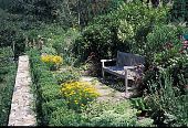 view [Lillie Hoeninghaus House]: sunset vista spot, with stepping stones to quiet bench. digital asset: [Lillie Hoeninghaus House]: sunset vista spot, with stepping stones to quiet bench.: 2001 Aug.