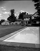 view [Bolte Garden]: back of house, with swimming pool in foreground and garage on far left. digital asset: [Bolte Garden] [safety film negative]: back of house, with swimming pool in foreground and garage on far left.