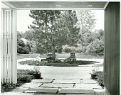 view [Ford Garden]: looking from main entrance courtyard toward circular driveway and Japanese-style garden. digital asset: [Ford Garden] [photographic print]: looking from main entrance courtyard toward circular driveway and Japanese-style garden.