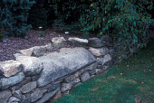 view [Oliver Nurseries, Inc.]: stone bench in stone wall. digital asset: [Oliver Nurseries, Inc.] [slide]: stone bench in stone wall.