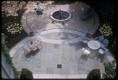 view [McGuire Garden]: bird's eye view of fountain, patio, flagstone and garden furniture including sunburst settee. digital asset: [McGuire Garden] [slide (photograph)]: bird's eye view of fountain, patio, flagstone and garden furniture including sunburst settee.