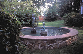 view [Applecross]: fountain with pool and sculpture, and wooden gate beyond. digital asset: [Applecross]: fountain with pool and sculpture, and wooden gate beyond.: 2002 Jun.