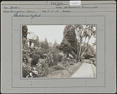 view [Tennyson Garden]: perennial border and path, with Aldworth House, once the home of Alfred, Lord Tennyson, on the left. digital asset: [Tennyson Garden] [photographic print]: perennial border and path, with Aldworth House, once the home of Alfred, Lord Tennyson, on the left.
