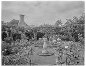 view [Miscellaneous Sites in England, Series 1]: rose garden with sundial in an unidentified location. digital asset: [Miscellaneous Sites in England, Series 1] [glass negative]: rose garden with sundial in an unidentified location.
