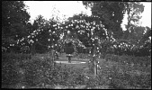 view [Sutton Place]: looking through a rose arbor to the fountain. digital asset: [Sutton Place] [negative]: looking through a rose arbor to the fountain.