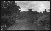 view [Sutton Place]: one end of the long garden border and grass path, showing grass stairs and a rustic work fence. digital asset: [Sutton Place] [negative]: one end of the long garden border and grass path, showing grass stairs and a rustic work fence.