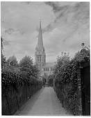 view [Miscellaneous Sites in Shere, Surrey, England, and Vicinity, Series 1]: St. Martin's Church in Dorking, Surrey, east of Shere, with one of the tallest church spires in England. digital asset: [Miscellaneous Sites in Shere, Surrey, England, and Vicinity, Series 1] [glass negative]: St. Martin's Church in Dorking, Surrey, east of Shere, with one of the tallest church spires in England.