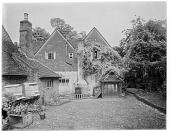 view [Miscellaneous Sites in Shere, Surrey, England, and Vicinity, Series 1]: a house, outbuildings, and courtyard with beehives in an unidentified location. digital asset: [Miscellaneous Sites in Shere, Surrey, England, and Vicinity, Series 1] [glass negative]: a house, outbuildings, and courtyard with beehives in an unidentified location.