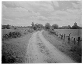 view [Miscellaneous Sites in Shere, Surrey, England, and Vicinity, Series 1]: a country road leading to a house and farm in an unidentified location. digital asset: [Miscellaneous Sites in Shere, Surrey, England, and Vicinity, Series 1] [glass negative]: a country road leading to a house and farm in an unidentified location.