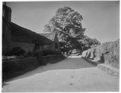 view [Miscellaneous Sites in Shere, Surrey, England, and Vicinity, Series 1]: an unidentified house with a stone roof. digital asset: [Miscellaneous Sites in Shere, Surrey, England, and Vicinity, Series 1] [glass negative]: an unidentified house with a stone roof.