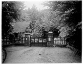 view [Miscellaneous Sites in Clovelly, Devon, England]: the gated entry and gatehouse at the lower end of The Hobby Drive along what is now the A39. digital asset: [Miscellaneous Sites in Clovelly, Devon, England] [glass negative]: the gated entry and gatehouse at the lower end of The Hobby Drive along what is now the A39.
