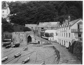 view [Miscellaneous Sites in Clovelly, Devon, England]: the harbor and quay at low tide, with the Red Lion Hotel on the right. digital asset: [Miscellaneous Sites in Clovelly, Devon, England] [glass negative]: the harbor and quay at low tide, with the Red Lion Hotel on the right.