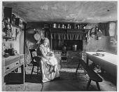 view [Miscellaneous Sites in Clovelly, Devon, England]: interior of a house with a woman and child. digital asset: [Miscellaneous Sites in Clovelly, Devon, England] [glass negative]: interior of a house with a woman and child.