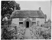 view [Unidentified Garden in England]: an unidentified thatch-roofed house and cottage garden. digital asset: [Unidentified Garden in England] [glass negative]: an unidentified thatch-roofed house and cottage garden.