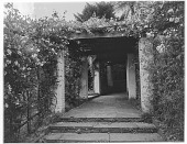 view [Unidentified Garden in England]: a rose-covered brick and rustic work pergola in an unidentified location. digital asset: [Unidentified Garden in England] [glass negative]: a rose-covered brick and rustic work pergola in an unidentified location.