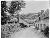 view [Miscellaneous Sites in Branscombe, Devon, England]: Locksey's Lane, with the Branscombe Forge on the left and the Forge Cottages on the right. digital asset: [Miscellaneous Sites in Branscombe, Devon, England] [glass negative]: Locksey's Lane, with the Branscombe Forge on the left and the Forge Cottages on the right.
