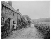 view [Miscellaneous Sites in Branscombe, Devon, England]: stone cottages along a street in Branscombe. digital asset: [Miscellaneous Sites in Branscombe, Devon, England] [glass negative]: stone cottages along a street in Branscombe.