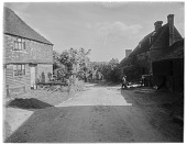 view [Miscellaneous Sites in Groombridge, Kent, England]: looking down the hill along Bird in Hand Street. digital asset: [Miscellaneous Sites in Groombridge, Kent, England] [glass negative]: looking down the hill along Bird in Hand Street.