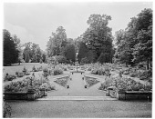 view [Wilton House and Vicinity]: the French style parterre garden, with the Holbein Porch barely visible in the distance. digital asset: [Wilton House and Vicinity] [glass negative]: the French style parterre garden, with the Holbein Porch barely visible in the distance.