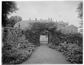 view [Clovelly Court]: looking from the walled garden toward the tennis court and house. digital asset: [Clovelly Court] [glass negative]: looking from the walled garden toward the tennis court and house.