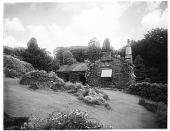 view [Miscellaneous Sites in the Lake District]: a house and garden along the lane leading up to Rydal Mount from the hamlet of Rydal. digital asset: [Miscellaneous Sites in the Lake District] [glass negative]: a house and garden along the lane leading up to Rydal Mount from the hamlet of Rydal.