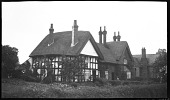 view [Unidentified Sites in England]: a group of unidentified houses with cottage gardens. digital asset: [Unidentified Sites in England] [negative]: a group of unidentified houses with cottage gardens.