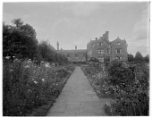view [Gravetye Manor]: looking from one of the gardens toward the house. digital asset: [Gravetye Manor] [glass negative]: looking from one of the gardens toward the house.