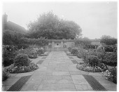 view [Orchards]: the formal Dutch Garden, with its flagstone paving and a lion's head wall fountain at the far end. digital asset: [Orchards] [glass negative]: the formal Dutch Garden, with its flagstone paving and a lion's head wall fountain at the far end.