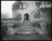 view [Orchards]: looking up to the house and terrace from the Dutch Garden. digital asset: [Orchards] [lantern slide]: looking up to the house and terrace from the Dutch Garden.