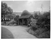 view [Miscellaneous Sites in London, England]: the Crescent Gardens, with Park Crescent in the background. digital asset: [Miscellaneous Sites in London, England] [glass negative]: the Crescent Gardens, with Park Crescent in the background.