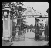 view [Dropmore]: gates and a walkway leading into the main garden. digital asset: [Dropmore] [lantern slide]: gates and a walkway leading into the main garden.