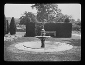 view [Court Farm]: a fountain topped by a Cupid sculpture. digital asset: [Court Farm] [lantern slide]: a fountain topped by a Cupid sculpture.