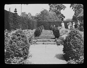view [Court Farm]: a terraced side garden, with a tall hedge separating it on the left from Broadway's High Street. digital asset: [Court Farm] [lantern slide]: a terraced side garden, with a tall hedge separating it on the left from Broadway's High Street.
